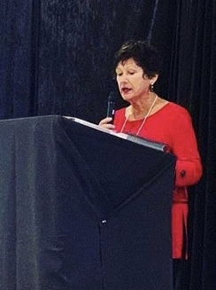Doreen speaking at an event