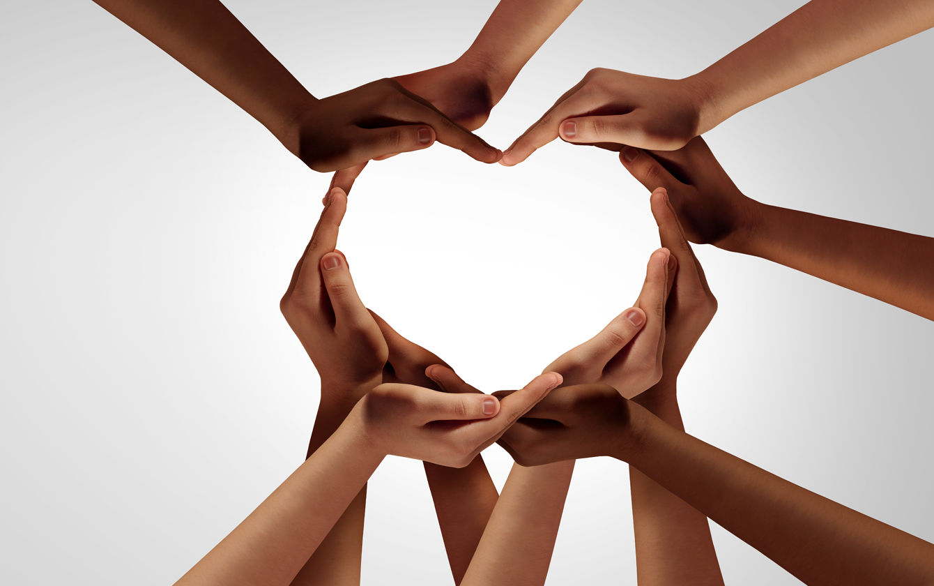 hands joining to form a heart