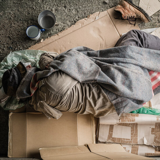 Homeless man sleeping on the ground