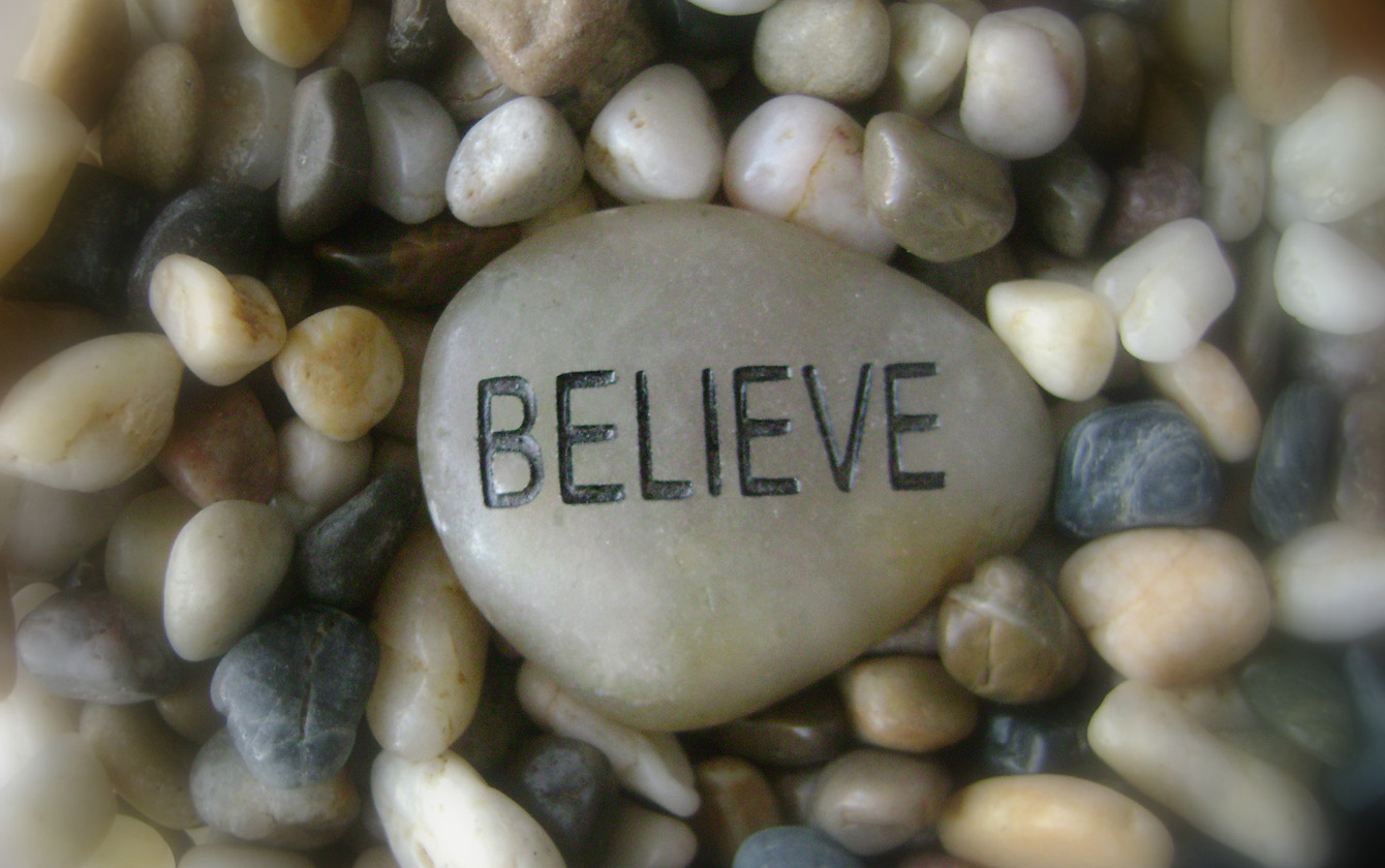 smooth stones with word Believe